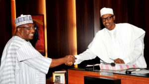Minister of Interior,General Danbazzau in a handshake with Pres.Buhari