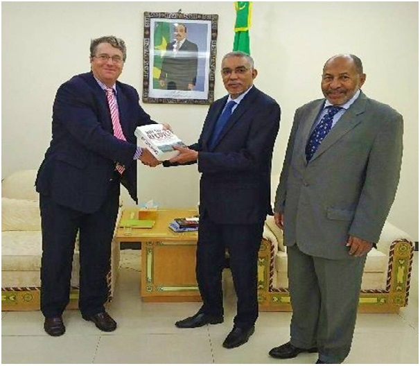 Photo: The author with the Prime Minister Hademine and Ambassador Dahane.