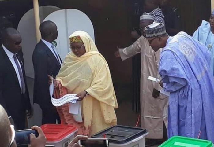 President Buhari Stares Curiously at Wife's Ballot Paper
